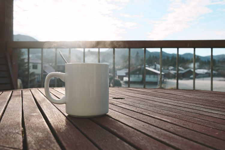 Morning coffee cup with mountain view. Cup Mug Table Drink No People Day Coffee Cup Sky Nature Food And Drink Refreshment Coffee Outdoors Aroma Morning Balcony Cappucino Mountain Hot Home Interior House Chill White Cup Smoke Sun