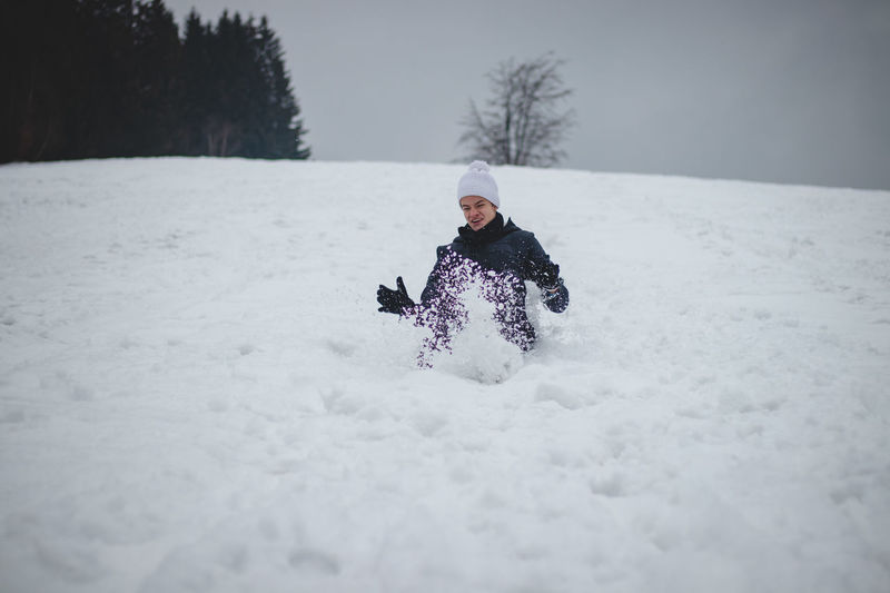 Woman on snow covered land