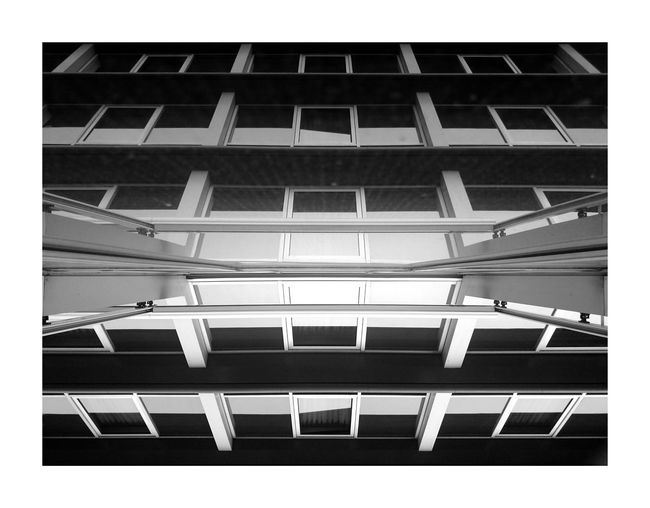 Architecture Building Exterior Built Structure Low Angle View Building Architectural Feature No People Building Story Modern Urban Geometry Just Taking Pictures Abstract Walking Around Travel Photography Paris Taking Photos Traveling Architecture Blackandwhite Black And White Black & White Repetition Colors and patterns Monochrome Photography Streetphotography The Street Photographer - 2017 EyeEm Awards