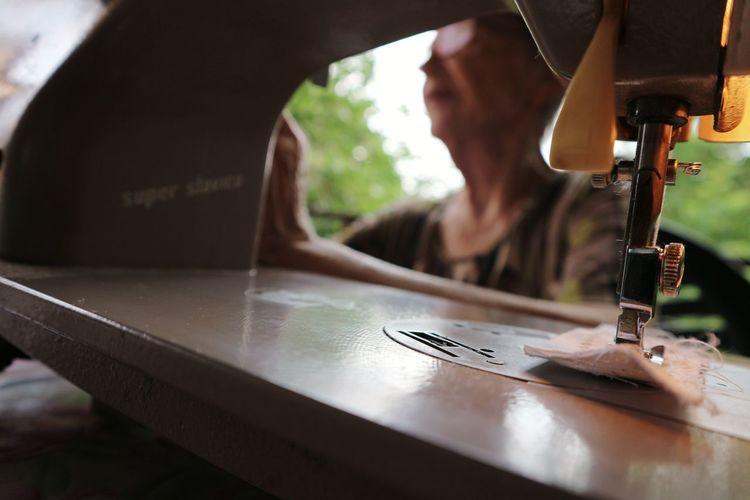 Woman sewing fabric on machine