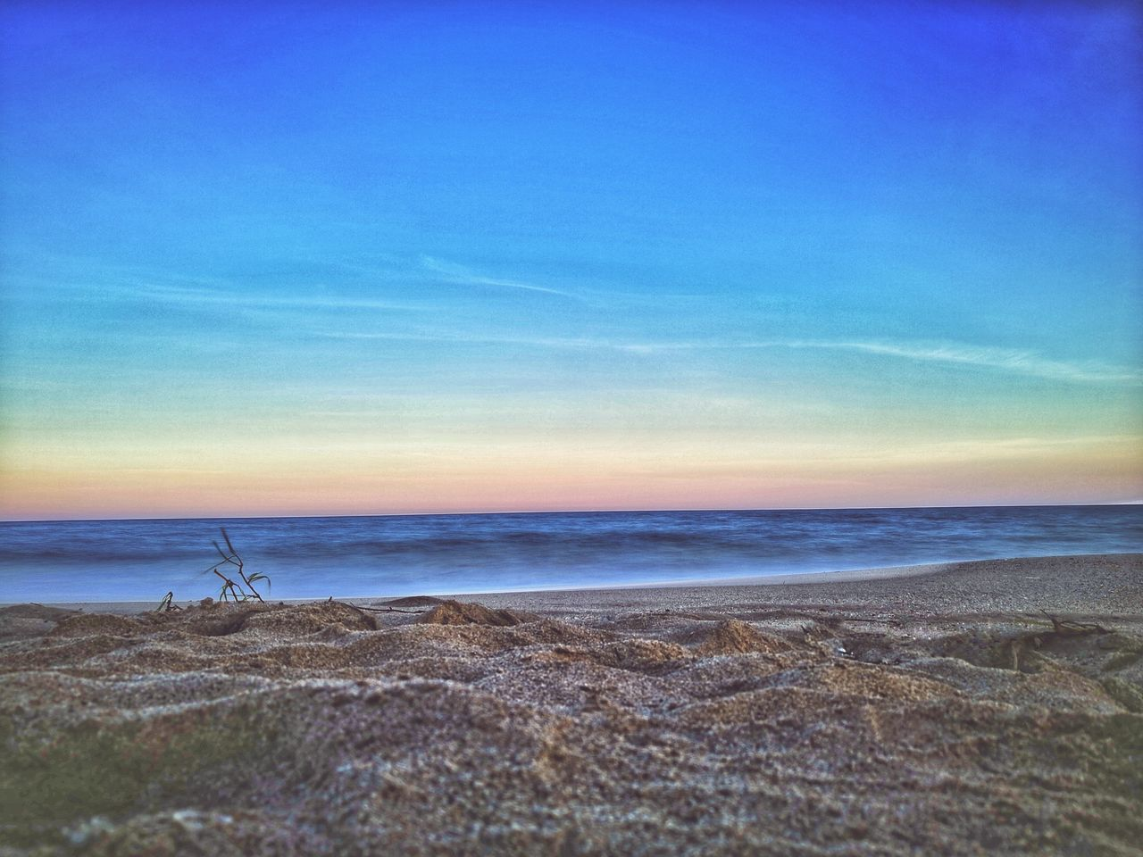 sea, beach, water, nature, beauty in nature, scenics, horizon over water, tranquility, tranquil scene, blue, no people, sand, outdoors, sky, sunset, day, wave