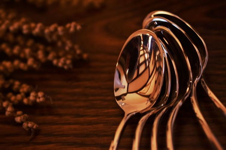 Close-up of metallic spoons on table