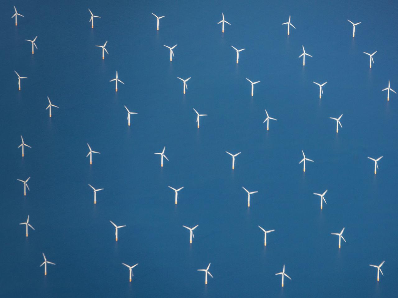 Full frame shot of windmills on sea