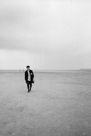 holkham beach norfolk england -- circa 1986 35mm Film Analogue Photography B&w Photography B&w Street Photography Cloudy Day East Anglia Filmisnotdead Full Length Getting Inspired Holkham Beach Horizon Over Water Inspiration Lifestyles Melancholy Mood Monochrome Norfolk Uk Outdoors Overcast Skies Sombre Tranquil Scene Walking On The Beach