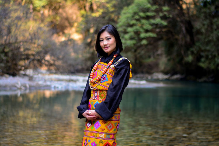 Women Around The World Water Dress Beauty Traditional Clothing River Spirituality Arts Culture And Entertainment Young Adult Travel Fashion Nature Beautiful People Outdoors One Person Serene People Adult Flower People Tranquility Beauty In Nature