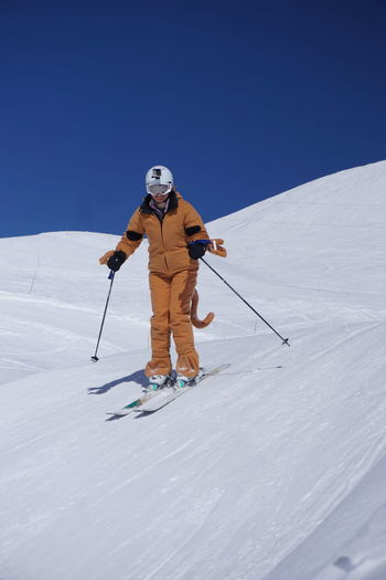 Skiing in Montgenevre Skiing Cold Temperature Full Length Holiday Leisure Activity Lifestyles Mountain Mountain Range One Person Real People Ski Holiday Ski Pole Ski-wear Skiing Sky Snow Sport Sports Equipment Trip Vacations Warm Clothing White Color Winter Winter Sport