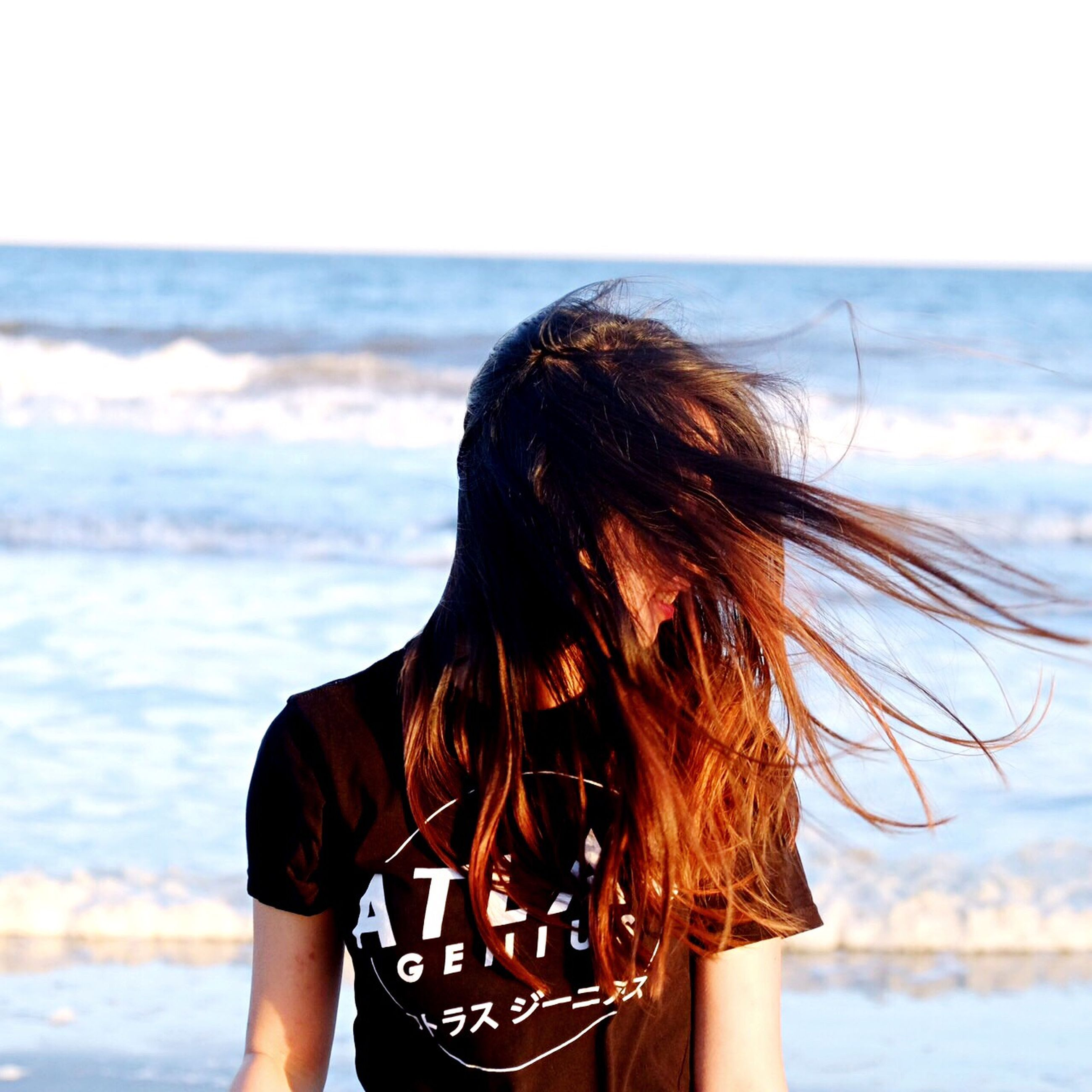 sea, long hair, person, water, lifestyles, leisure activity, rear view, young women, horizon over water, focus on foreground, beach, sky, young adult, brown hair, waist up, headshot, standing, nature