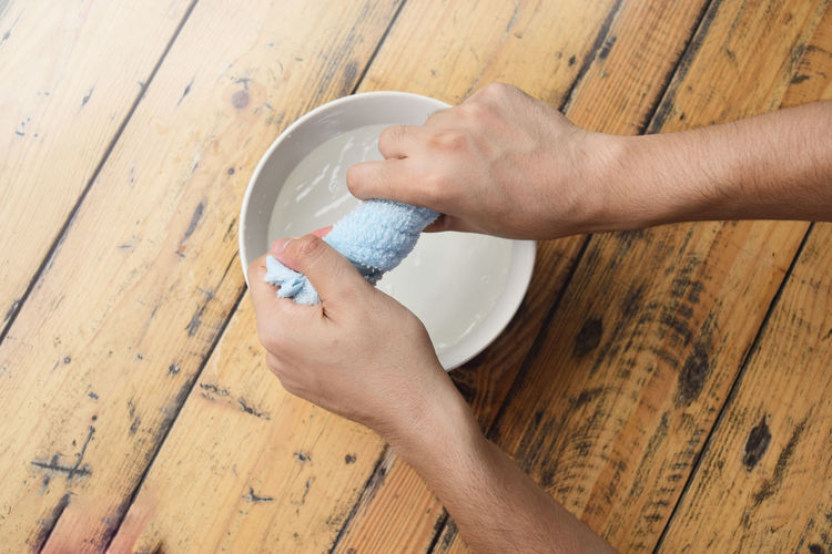 Squeezing of fabric on wood table. Human Hand Wood - Material Wood Flooring Basin Bath Bowl Care Clean Cloth Healthy Housework Laundry Service Skin Squeeze Table Wash Water Wet Maid Work
