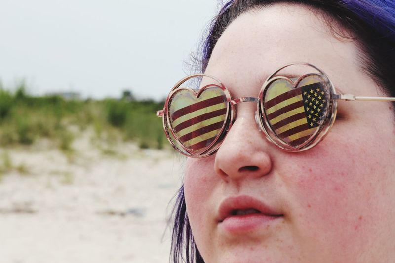 Close up American flag reflection in sunglasses on a modern woman Heart Shaped Sunglasses Freedom Americam Flag USA America Celebration 4th Of July Independence EyeEm Selects Headshot One Person Portrait Real People Close-up Leisure Activity Glasses Lifestyles Day Young Adult Focus On Foreground Land Nature Beach Young Women Human Face Human Body Part Body Part Outdoors The Portraitist - 2019 EyeEm Awards