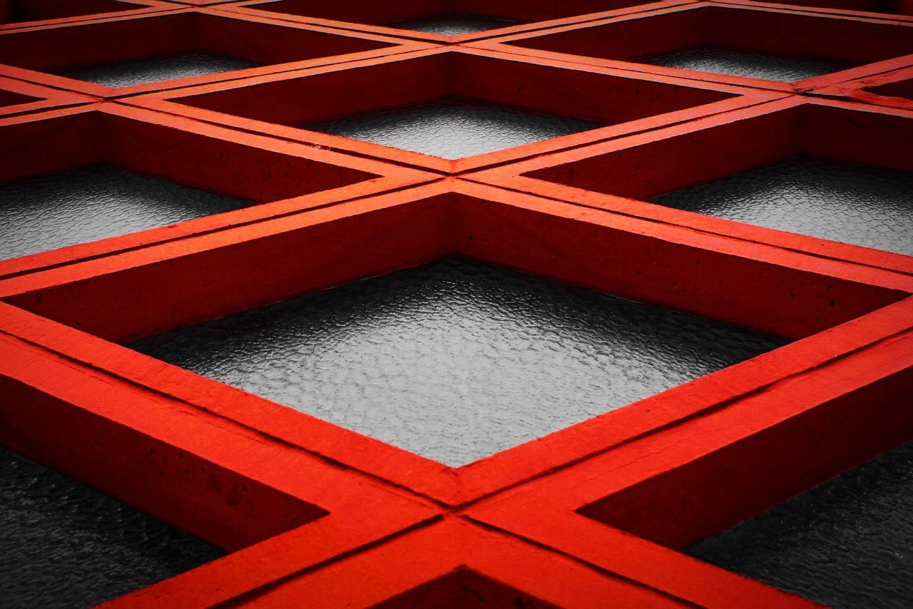 Full Frame Shot Of Red Pattern On Glass