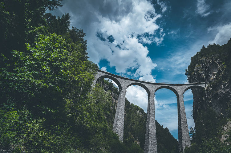 Landwasserviadukt in Switzerland. Arch Architecture Beauty In Nature Bridge - Man Made Structure Built Structure Cloud - Sky Connection Day Green Color Growth Low Angle View Nature No People Outdoors Sky Switzerland Transportation Tree Viaduct