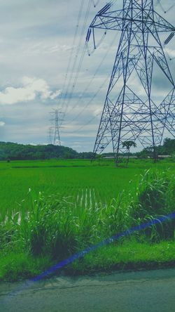 Transmission tower Transmission Tower Rural Urban Nature Electricity  Power Connected Field Green EyeEm EyeEm Nature Lover EyeEm Gallery Rice Field Engineering Steel Tower  Sky And Clouds Daylight Connection Connected With Nature Technology Development Upclose Street Photography Blue Line Light Intensity Showing Imperfection The Great Outdoors With Adobe