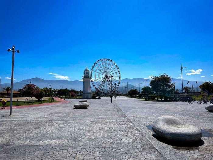 Ferris wheel against sky in city