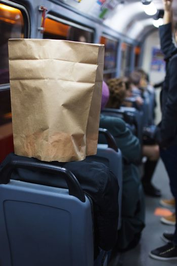 man with paper bag on his head rides the bus Sitting Hipster Bag On Head Bus Transportation Mode Of Transportation Incidental People Focus On Foreground Bag Men