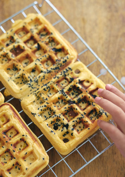Close-up of waffles on metal grate