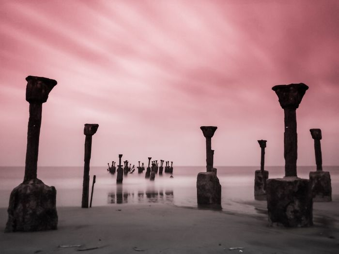 Broken pier - took this shot just before dawn on a full moon day. super long exposure shot on mobile