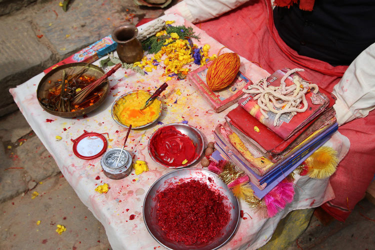At dakshinkali temple, a man has his table set to paint holy bindus in a short ceremony.