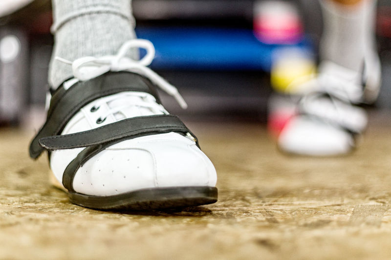 Low section of athlete wearing shoes