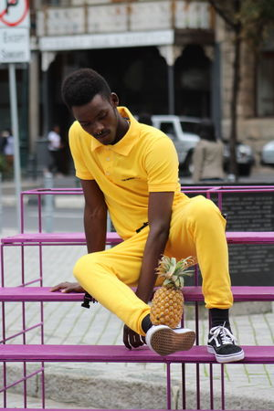 Architecture Built Structure Casual Clothing Clothing Day Focus On Foreground Full Length Leisure Activity Lifestyles Looking Away One Person Outdoors Railing Real People Seat Sitting Sport Yellow Young Adult Young Men The Fashion Photographer - 2018 EyeEm Awards