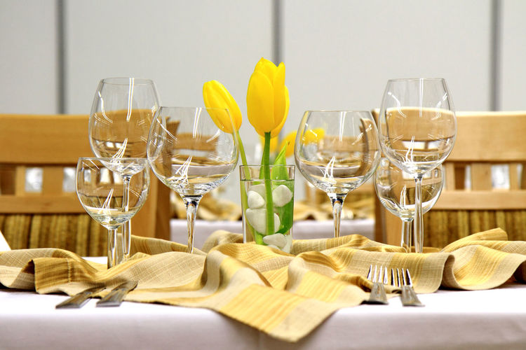 View of wineglasses with flower on table