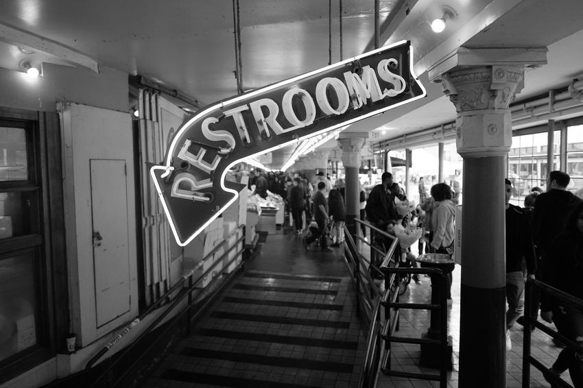 Restrooms Downstairs Group Of People Crowd Transportation Built Structure Indoors  Text Sign Illuminated Ceiling
