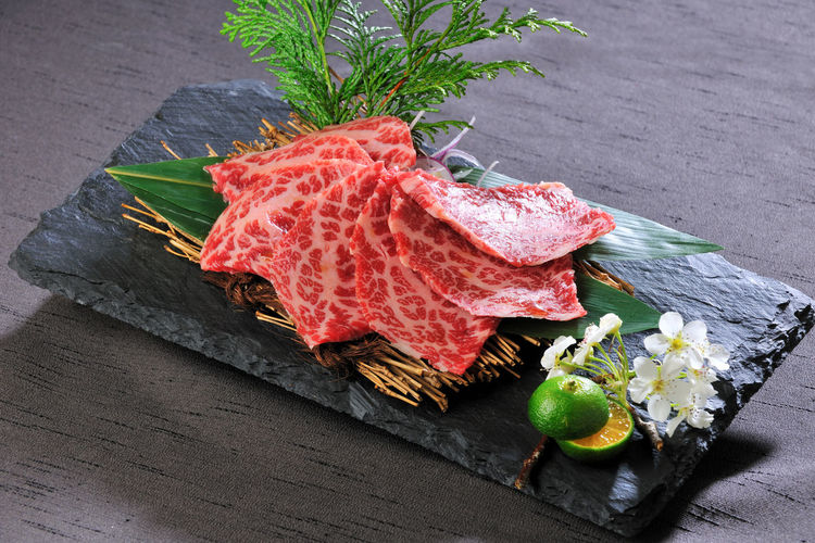 High angle view of meat on slate over table
