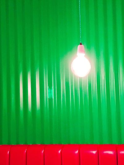 Interior Design Lighting Equipment Green Color No People Electricity  Indoors  Leather Seating Against A Green Wall Caribbean Restaurant Textures And Surfaces The Week On EyeEm Bold Bright Vertical Lines Bold Colors Bold And Beautiful Light Bulb Hanging From The Ceiling Against A Green Wall AI Now