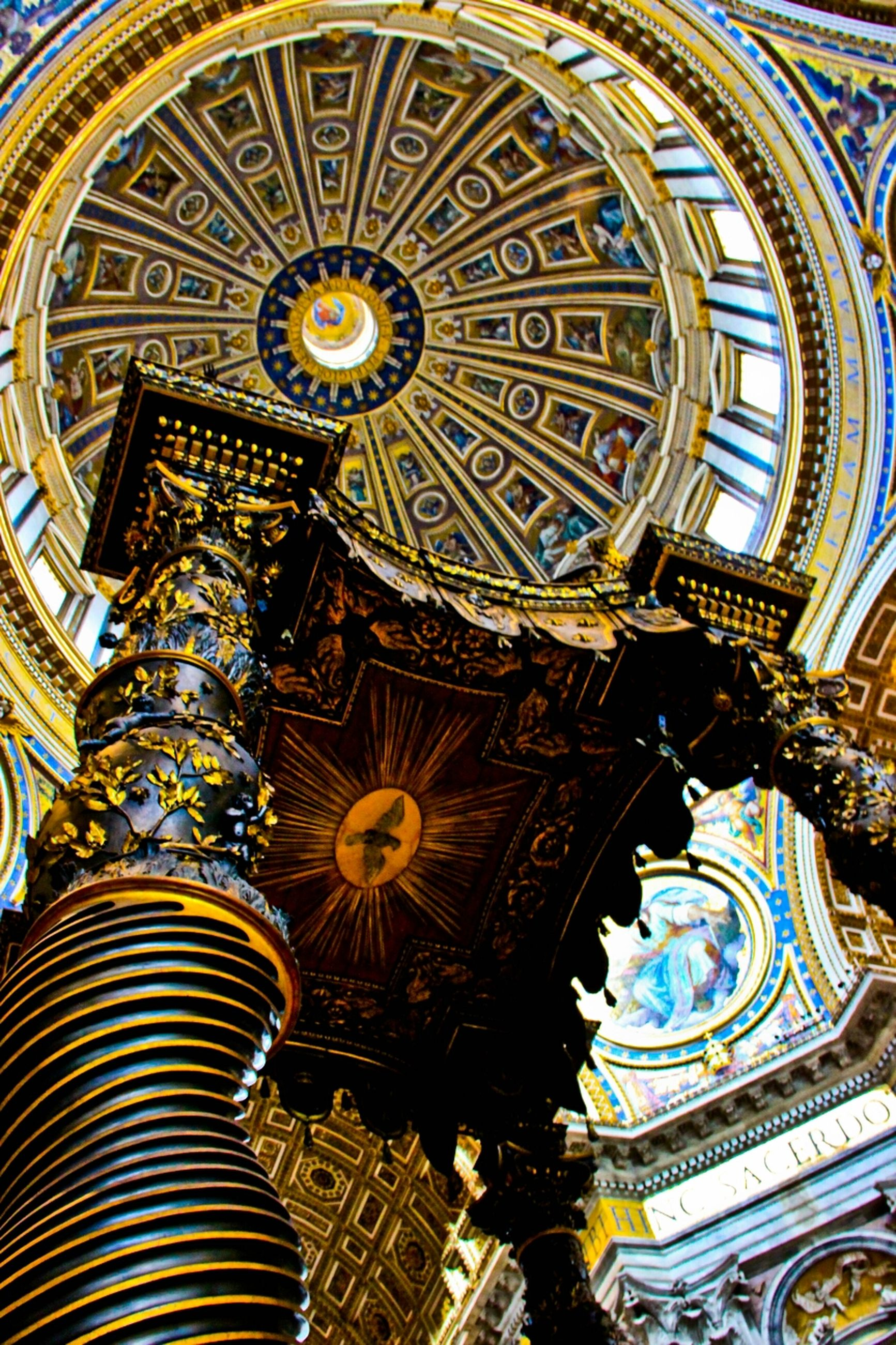 place of worship, architecture, religion, built structure, low angle view, spirituality, ornate, church, indoors, famous place, architectural feature, cathedral, design, ceiling, travel destinations, tourism, pattern, dome