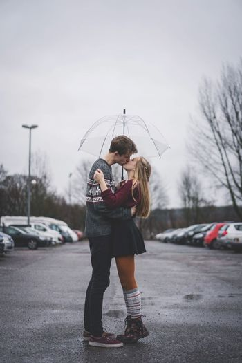 Lovely Skirt Kisses Umbrella Couple Love Kiss Full Length Real People Lifestyles Young Adult Car Leisure Activity Young Women Motor Vehicle Winter Transportation Women Mode Of Transportation Standing Child Nature Cold Temperature Human Arm Day Warm Clothing Teenager