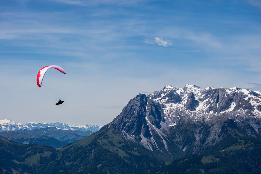 Paraglider souring over the alps near Werfenweng, Austria Austria Austria Mountains Paragliding Adventure Alps Cloud - Sky Extreme Sports Flying Freedom Mountain Mountain Peak Mountain Range Mountains Mountains And Sky Outdoors Parachute Paraglide Paraglider Paragliding Sky Snowcapped Mountain Sport Tranquility