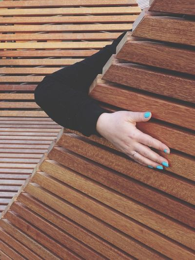 High angle view of woman hand on wooden table
