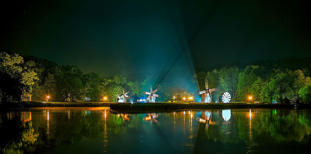 Lake night scene with windmills. Dumbrava lake, Astra Museum of Traditional Folk Civilization, Sibiu city, Romania Night Scene Romania Sibiu, Romania Windmills Beauty In Nature Dumbrava Folk Illuminated Lake Lake Night Light Beam Museum Of Natural History Nature Nautical Vessel Night Outdoors Real People Reflection Scenics Sibiu Sky Traditional Tree Water Waterfront