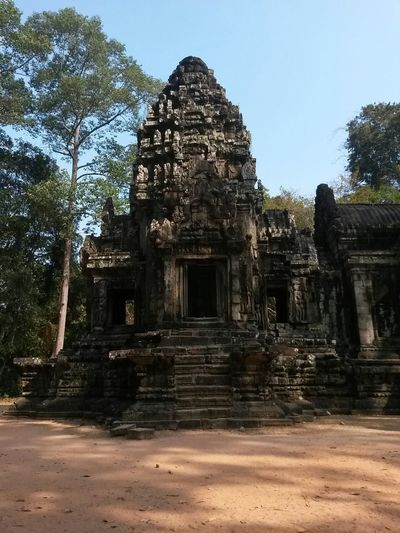 Cambodia South East Asia Ancient Ancient Civilization Angkor Archaeology Architecture Belief Building Built Structure History Nature No People Old Old Ruin Outdoors Place Of Worship Religion Ruined Spirituality The Past Tourism Travel Travel Destinations Tree