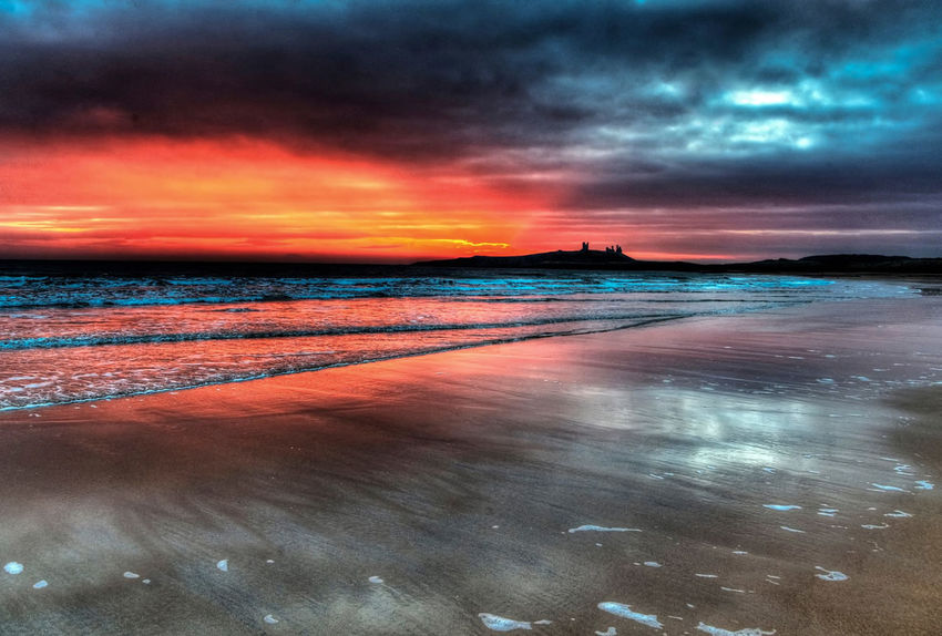 Dawn at the ruins Dunstanburgh Castle Embleton North Sea Coast Surf Ancient Ruins Beach Beauty In Nature Cloud - Sky Day Dramatic Sky Horizon Over Water Nature No People Northumberland Coastline Outdoors Scenics Sea Sky Sunset Tranquil Scene Tranquility Water