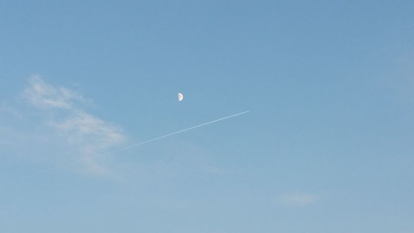 moon on the afternoon sky Moon Moon Light Moon And Clouds Moon_of_the_day Vapor Trail Flying Airplane Sky Transportation Airshow Low Angle View Nature Outdoors