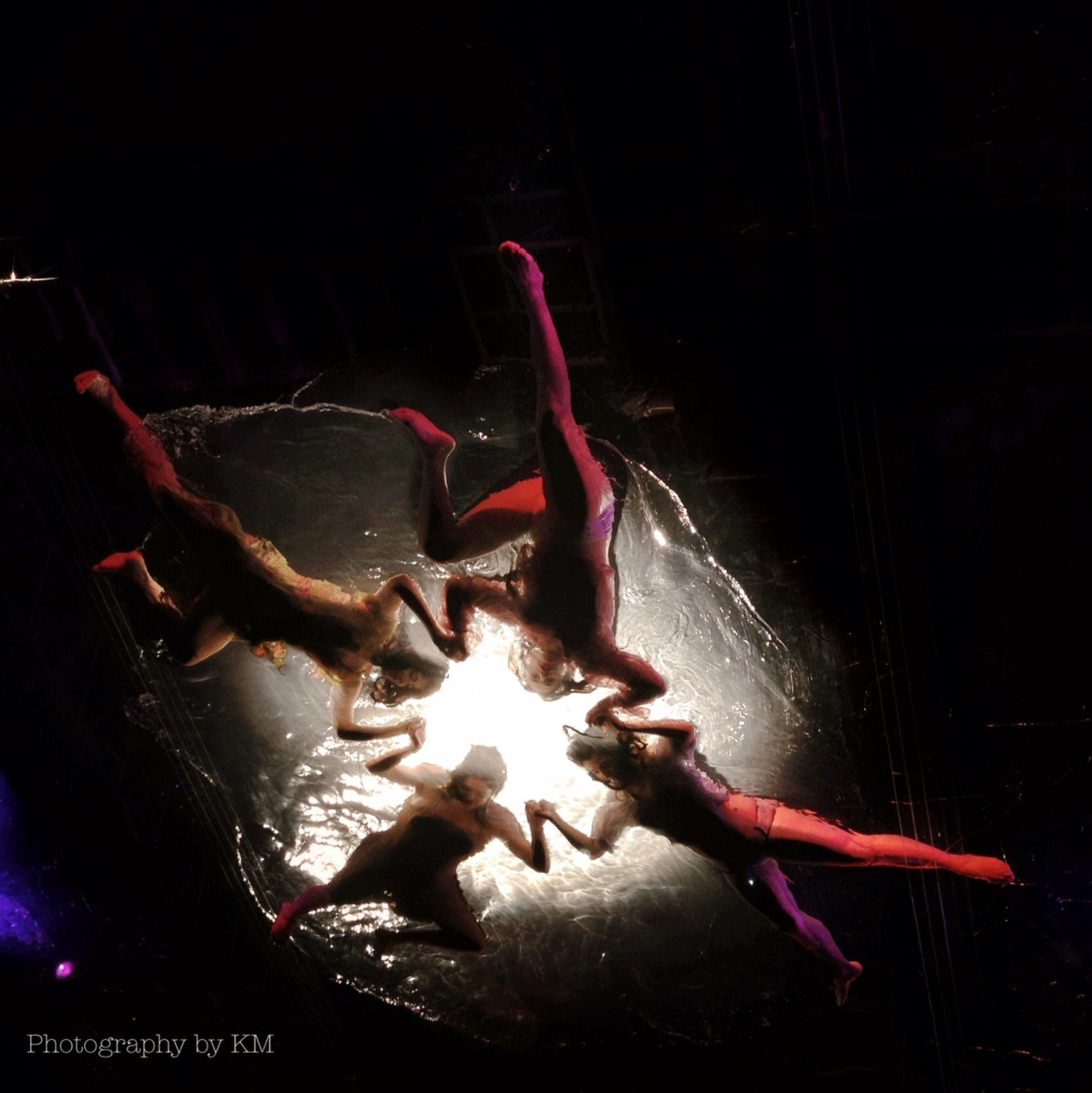 night, indoors, burning, illuminated, fire - natural phenomenon, flame, animal themes, close-up, no people, performance, heat - temperature, art and craft, high angle view, fish, arts culture and entertainment, animal representation, smoke - physical structure, dark