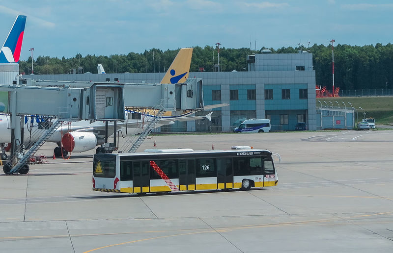 Runway and bus to transport passengers, delivery of people from the plane Transportation Mode Of Transportation Architecture Built Structure Public Transportation City Land Vehicle Building Exterior Day Travel Nature Outdoors Incidental People Road Airport Sky Rail Transportation Sign Air Vehicle Motion