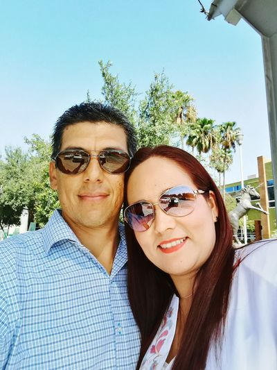 Sunglasses Portrait Two People Looking At Camera Togetherness Adults Only Adult Mid Adult Headshot Mid Adult Men Heterosexual Couple Day People Eyeglasses  Outdoors Front View Human Body Part Men Young Adult Sky