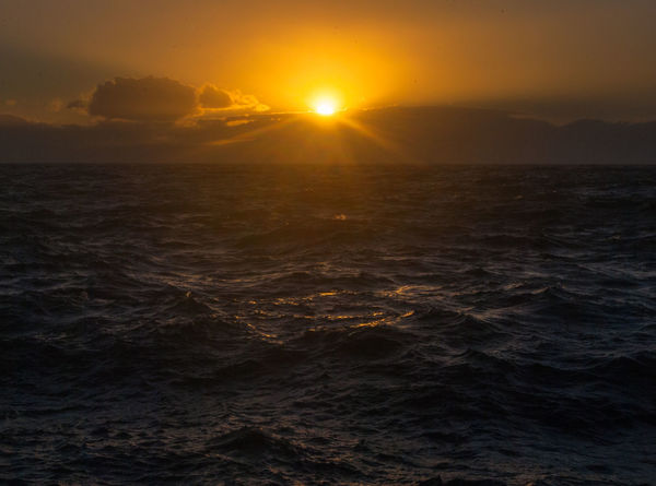 Sunset Sky Sun Beauty In Nature Sea Scenics - Nature Water Nature Idyllic Sunlight Waterfront Tranquility Orange Color Tranquil Scene No People Non-urban Scene Wave Outdoors Cloud - Sky Horizon Over Water Lens Flare Bright