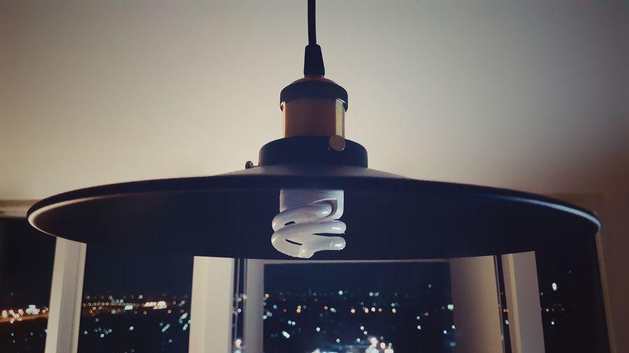 Vintage Lamp with Modern Spiral Light Bulb in Bedroom Condominium Condo Apartment Design Interior No People Room