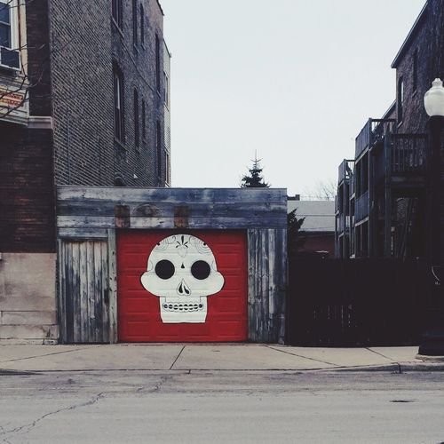 Street Art Streetart Streetart/graffiti Chicago Andersonville Saturday Exploring Urban Landscape Urbanexploration Skull Muerte Diademuertos Graffiti Graffiti Art Red Garage Wood Wood - Material Wooden Canvas
