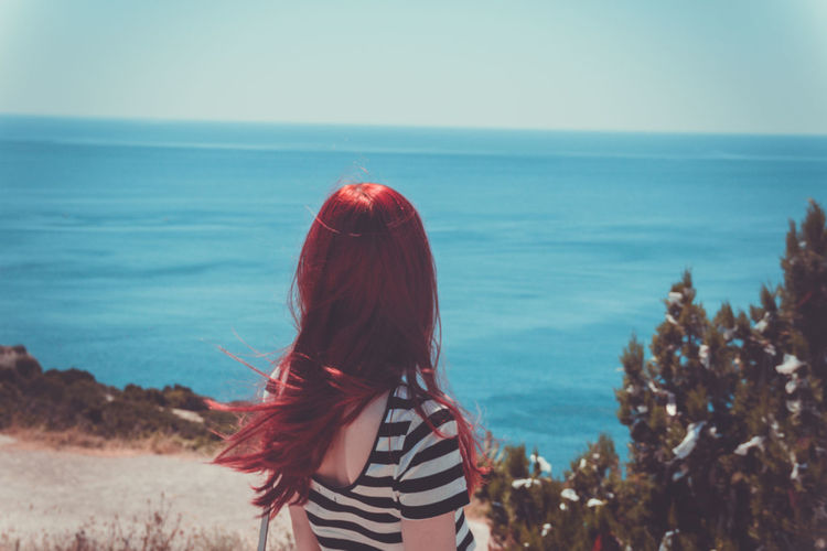 Beach Beauty In Nature Clear Sky Day Female Horizon Over Water Leisure Activity Lifestyles Long Hair Nature One Person Outdoors Real People Rear View Red Redhair Redhead Russia Scenics Sea Sky Standing Water Women Young Adult An Eye For Travel