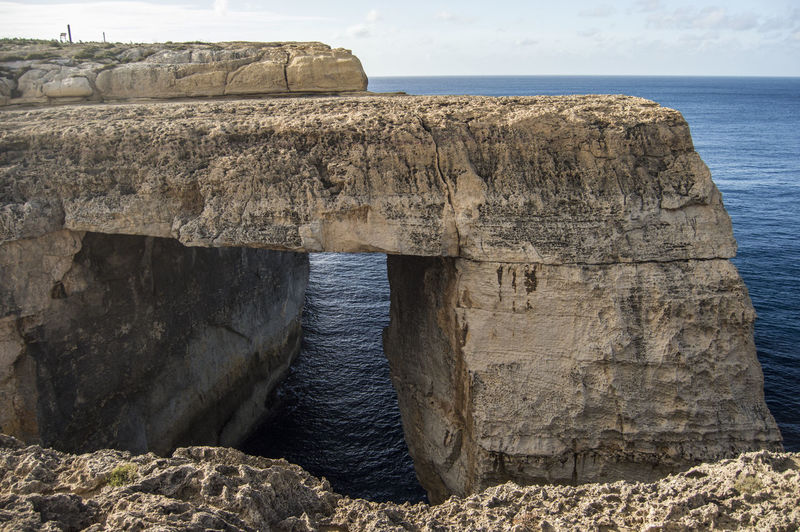 At Wied il-Miellah Gozo Malta Cliff Day Eroded Erosion Geology Gharbetiba Gozo Gozo Island Physical Geography Rock Rock - Object Rock Formation Rocky Rough Sea Sea And Sky Showcase: February Window