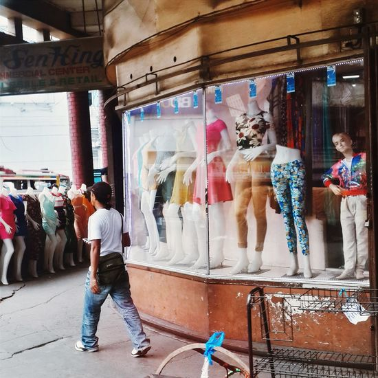Full length of people standing in market