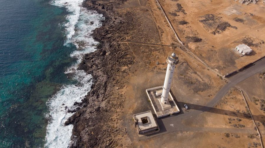 Lighthouse EyeEmNewHere Waves Ocean Lighthouse High Angle View Land Day Nature Sand Sunlight Outdoors No People Beach Aerial View Water Travel Pattern
