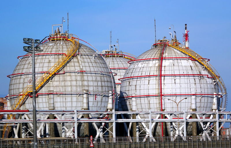 Large spherical fuel storage tanks Fire Hazard Sphere Building Exterior Built Structure Flammable Fuel And Power Generation Fuel Pipe Fuel Storage Tank Industrial Installation Industry Ladders Sky Spherical Storage Tanks