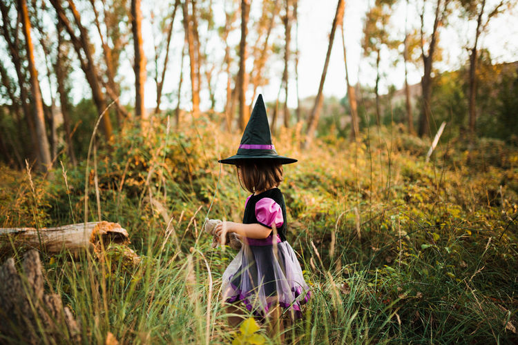 Girl wearing costume during halloween walking at forest