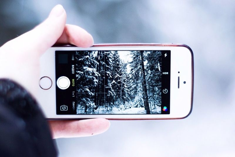Person photographing through smart phone