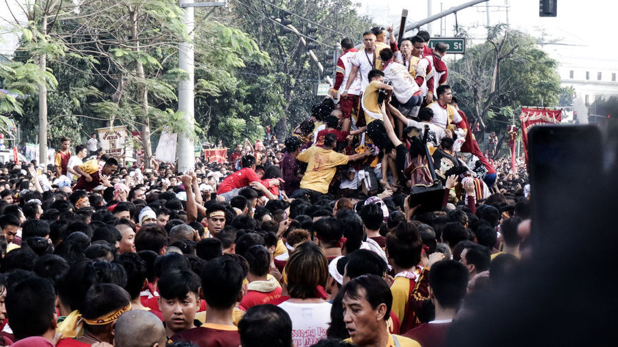feast of Black Nazarene Philippines FilipinoStreetPhotographers Filipino Filipino Stories Catholic Catholic Faith Holy Festival Black Nazarene Festival Faith Faith&devotion Faith In God Crowd Tree Men Women City Building Exterior Festival Parade Traditional Festival Holy Week Protestor Marching Traditional Dancing Holi