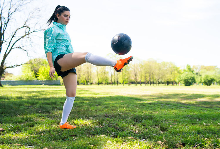 Woman playing with ball on field